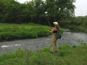 Woman Fly Fishing - Photo by Barb Romberg